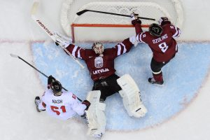 Latvia's goalkeeper Kristers Gudlevskis (C) vies with Canada's Rick Nash (L) during the Men's Ice Hockey Quarterfinals Canada vs Latvia at the Bolshoy Ice Dome during the Sochi Winter Olympics on February 19, 2014.  AFP PHOTO / ALEXANDER NEMENOVALEXANDER NEMENOV/AFP/Getty Images
